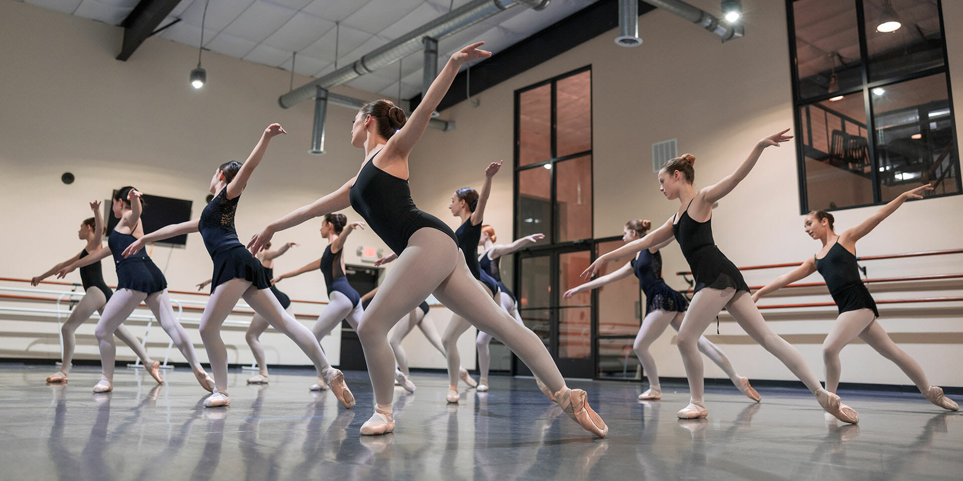 Free trial dance class ballet instruction Northern Virginia - group of ballerinas holding pose